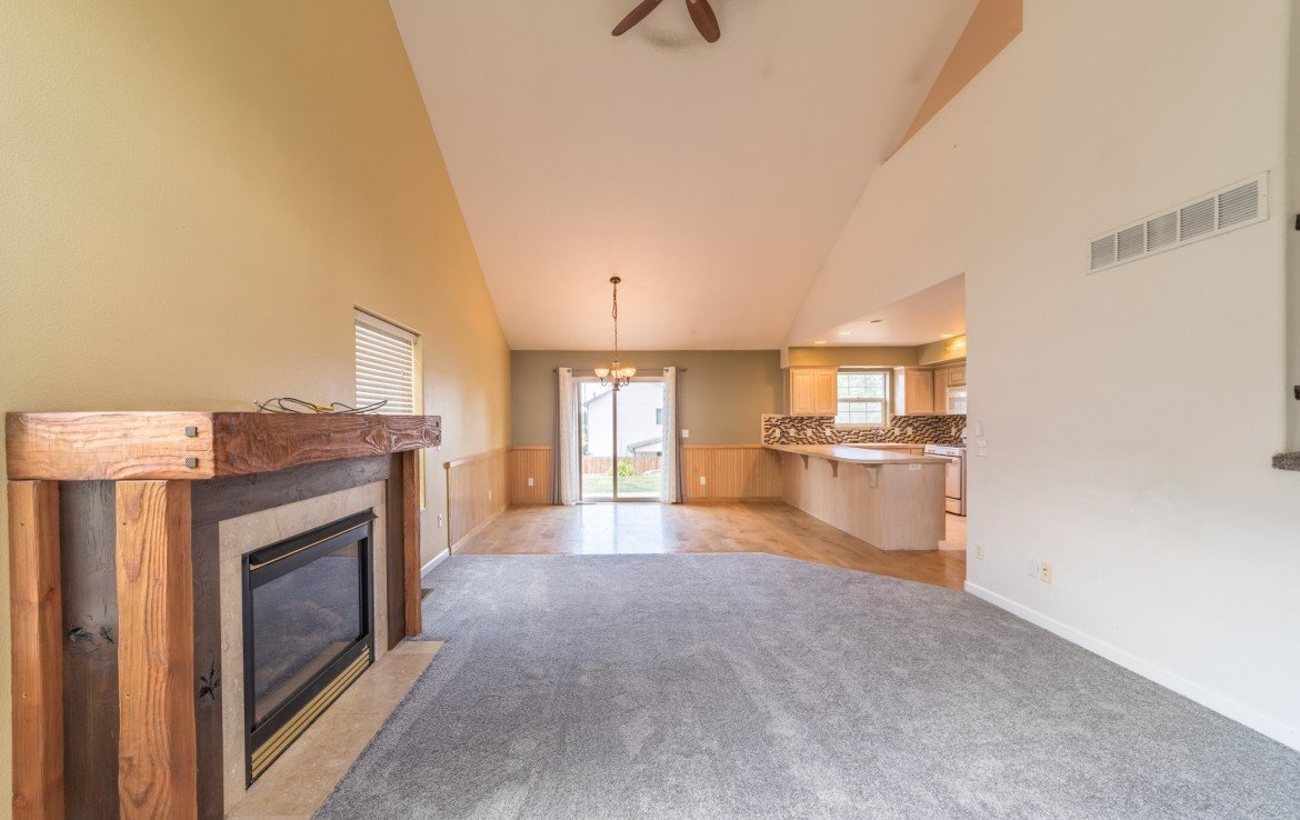 Living Room with Gas Log Fireplace - 2051 Cherry St Montrose, CO - Atha Team Real Estate Agents