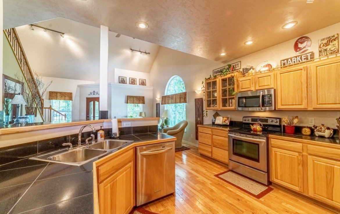 Kitchen with Bar for Stool Seating - 3208 Silver Fox Dr Montrose CO 81401 - Atha Team at Keller Williams