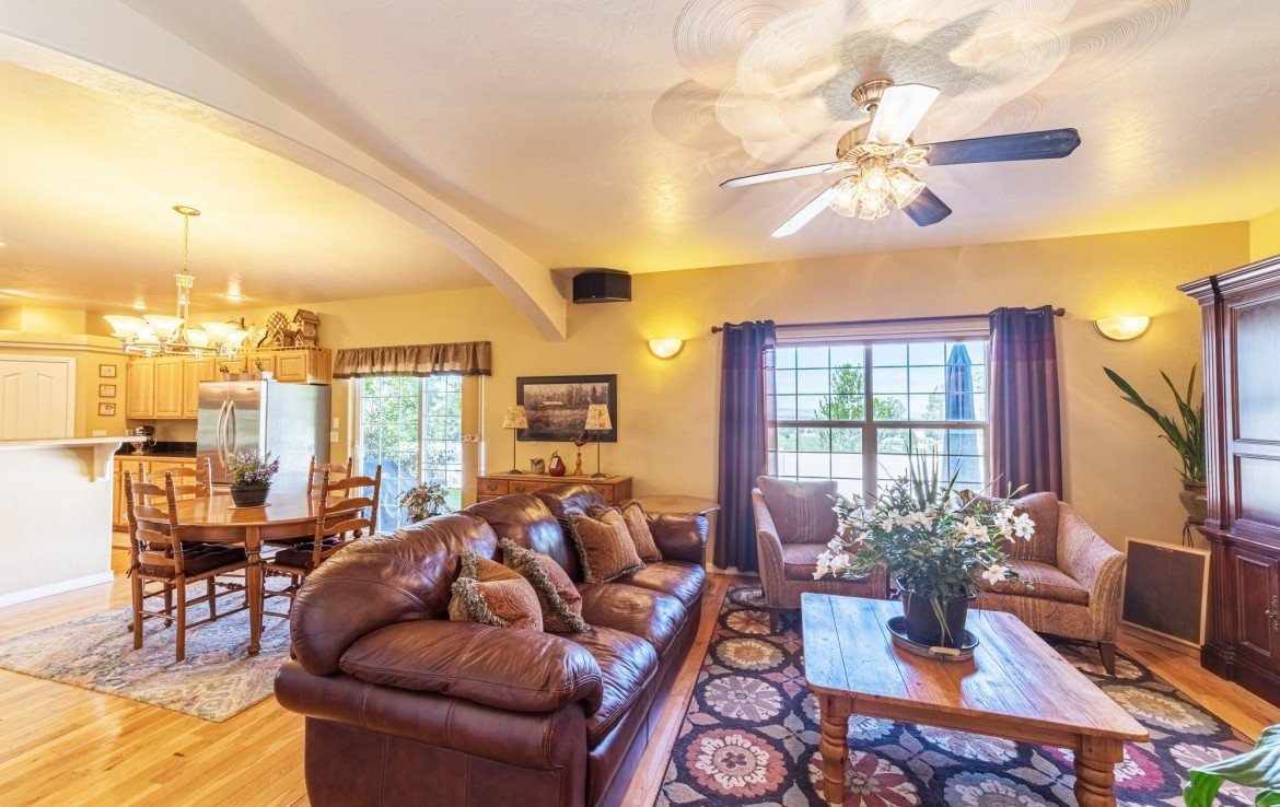 Living Room with Bay Windows - 3208 Silver Fox Dr Montrose CO 81401 - Atha Team at Keller Williams
