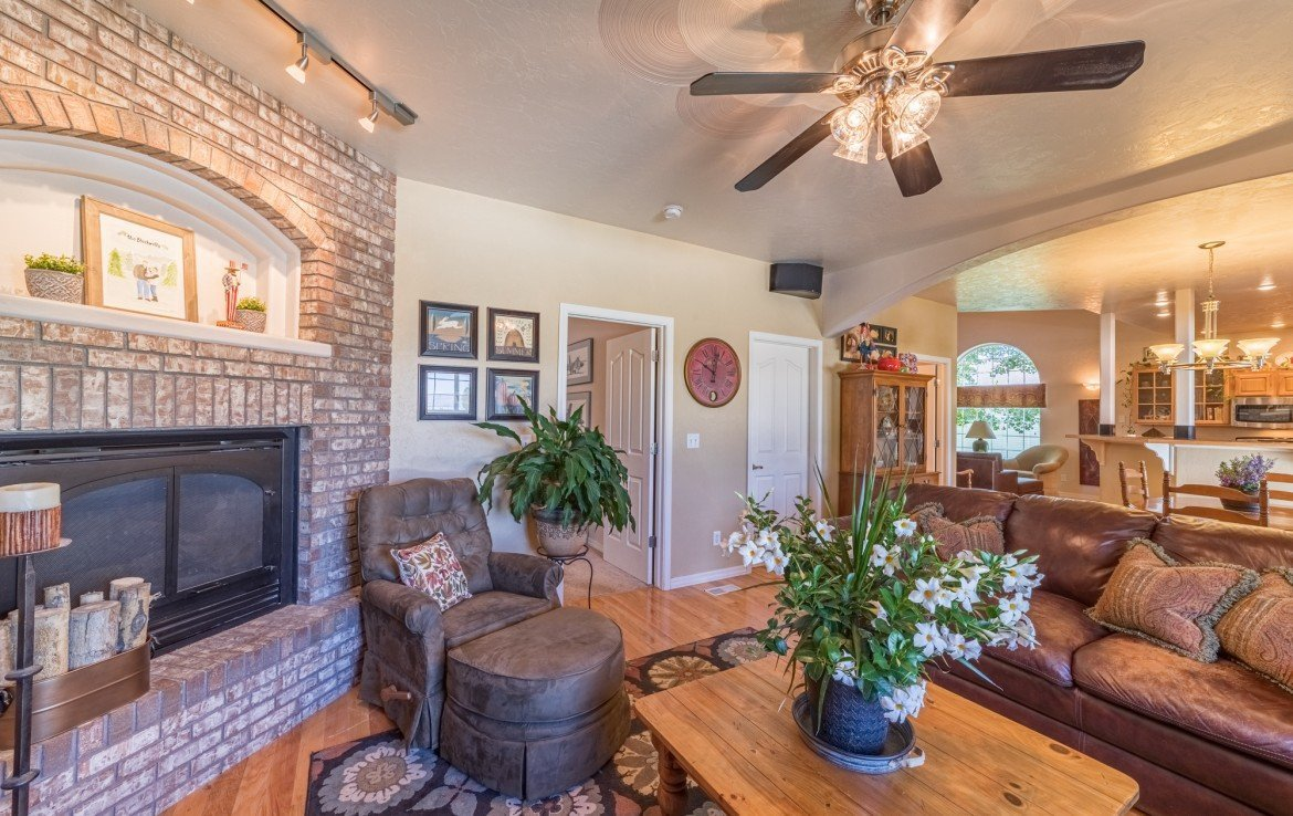 Living Room with Gas Log Fireplace - 3208 Silver Fox Dr Montrose CO 81401 - Atha Team at Keller Williams