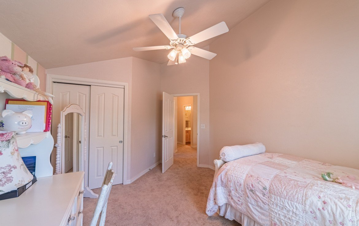 Upstairs Bedroom with Ceiling Fan - 3208 Silver Fox Dr Montrose CO 81401 - Atha Team at Keller Williams