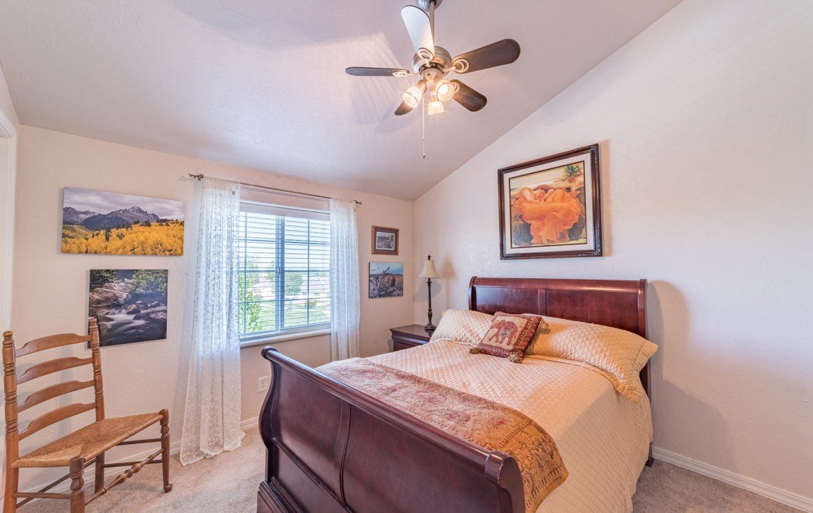 2nd Upstairs Bedroom with Ceiling Fan - 3208 Silver Fox Dr Montrose CO 81401 - Atha Team at Keller Williams