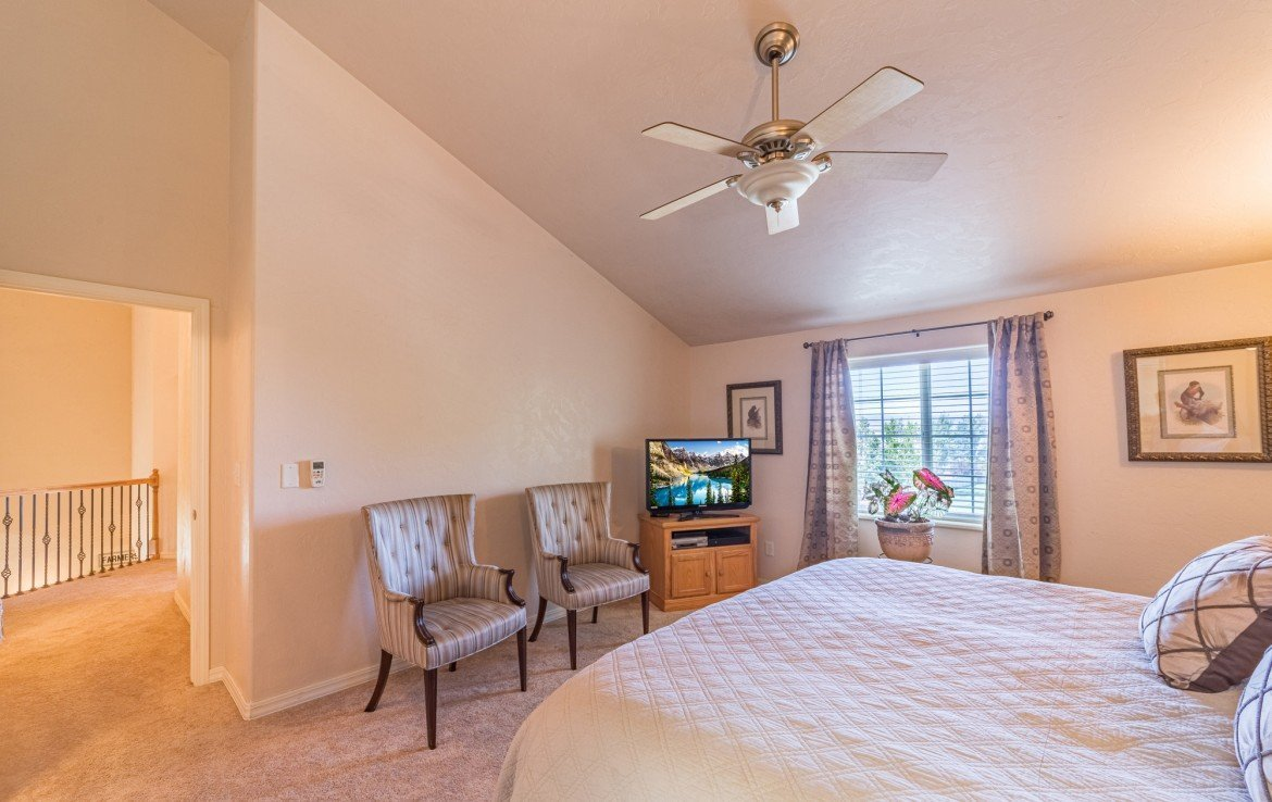 Upstairs Master Bedroom with Ceiling Fan - 3208 Silver Fox Dr Montrose CO 81401 - Atha Team at Keller Williams