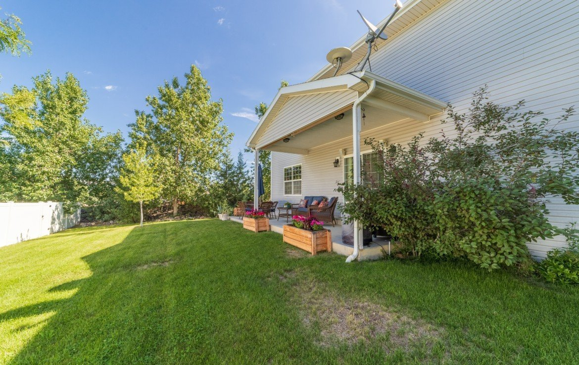 Covered Back Porch - 3208 Silver Fox Dr Montrose CO 81401 - Atha Team at Keller Williams