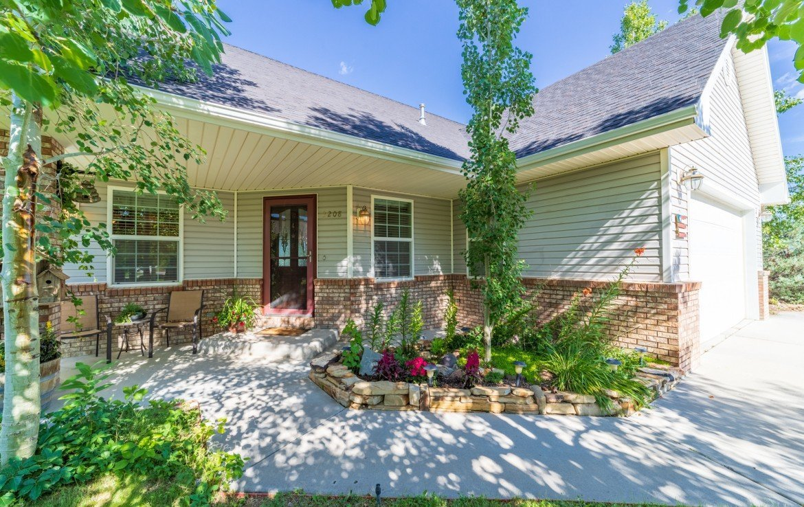 Front Patio with Landscaping - 3208 Silver Fox Dr Montrose CO 81401 - Atha Team at Keller Williams