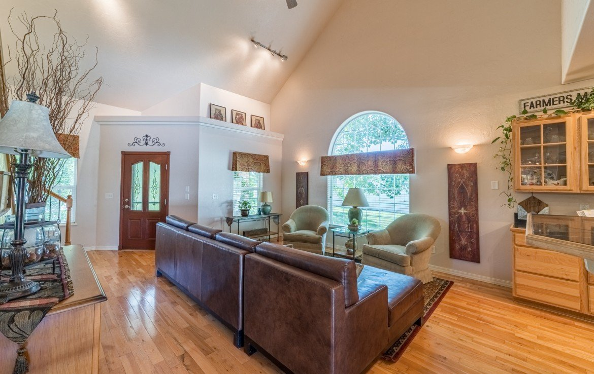 Formal Living Room with Track Lighting - 3208 Silver Fox Dr Montrose CO 81401 - Atha Team at Keller Williams