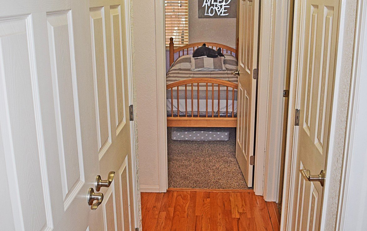 Hallway with Wood Laminate Flooring - 1141 Anthracite Creek Ave Montrose CO 81401 - Atha Team Real Estate