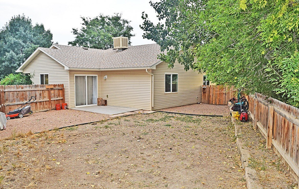 Privacy Fenced Back Yard with Patio - 1141 Anthracite Creek Ave Montrose CO 81401 - Atha Team Real Estate