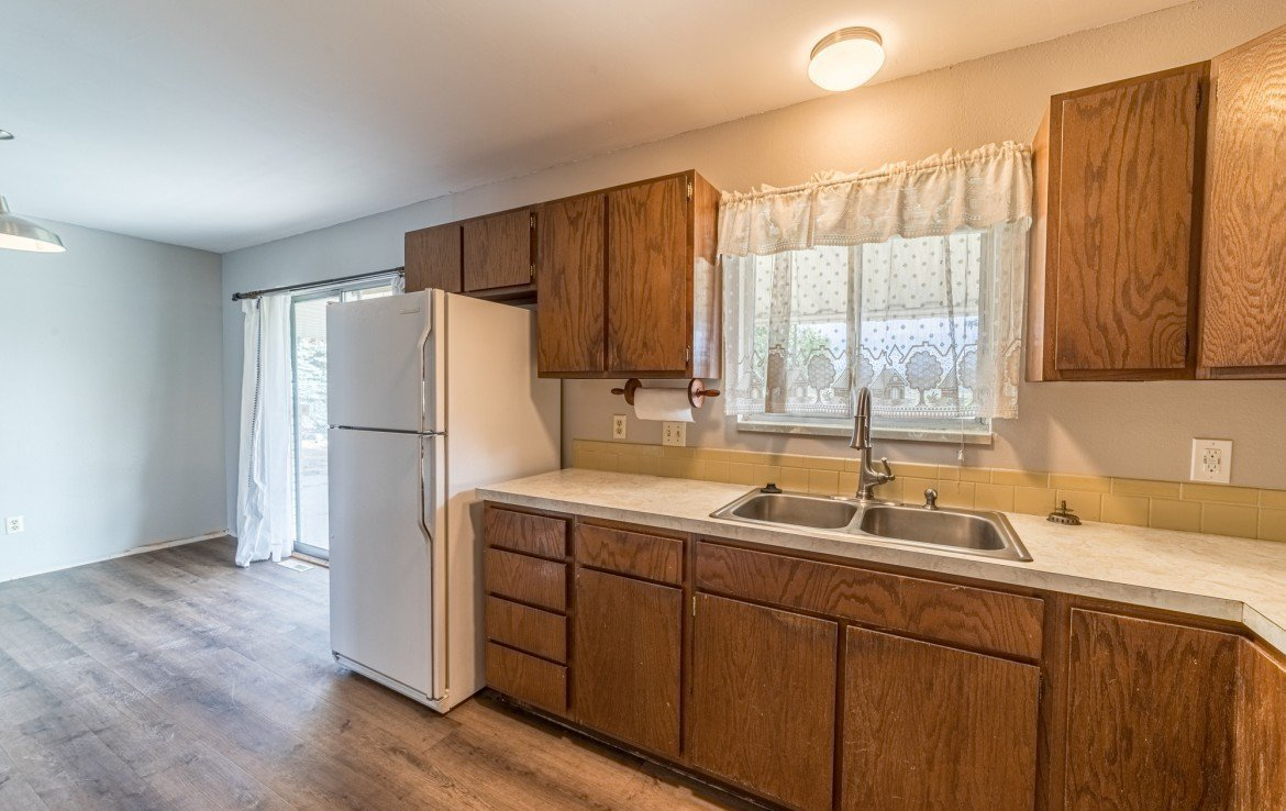 Kitchen with New Flooring - 1717 Dover Rd Montrose, CO 81401 - Atha Team Real Estate for Sale