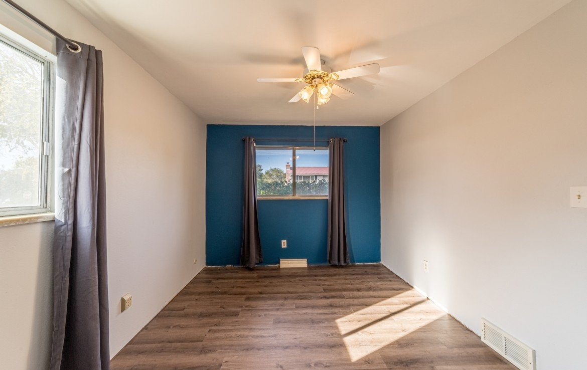 Large Bedroom with new Lux Vinyl Flooring - 1717 Dover Rd Montrose, CO 81401 - Atha Team Real Estate for Sale