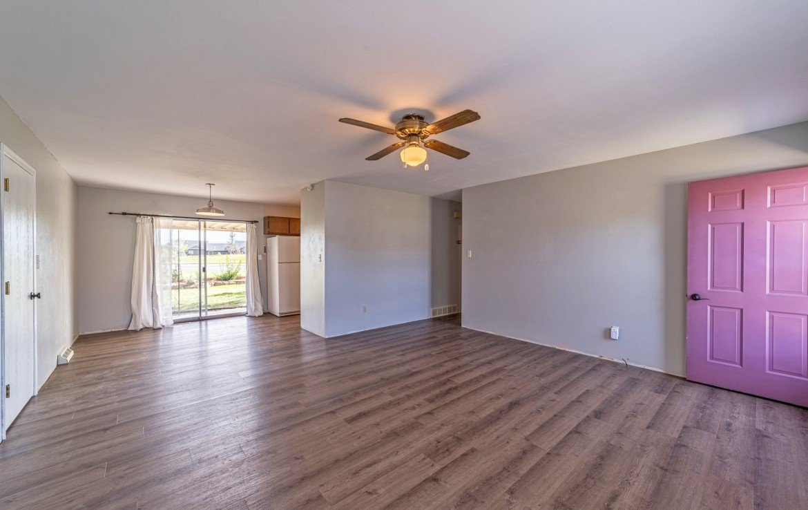 Living Room with New Lux Vinyl Flooring - 1717 Dover Rd Montrose, CO 81401 - Atha Team Real Estate for Sale