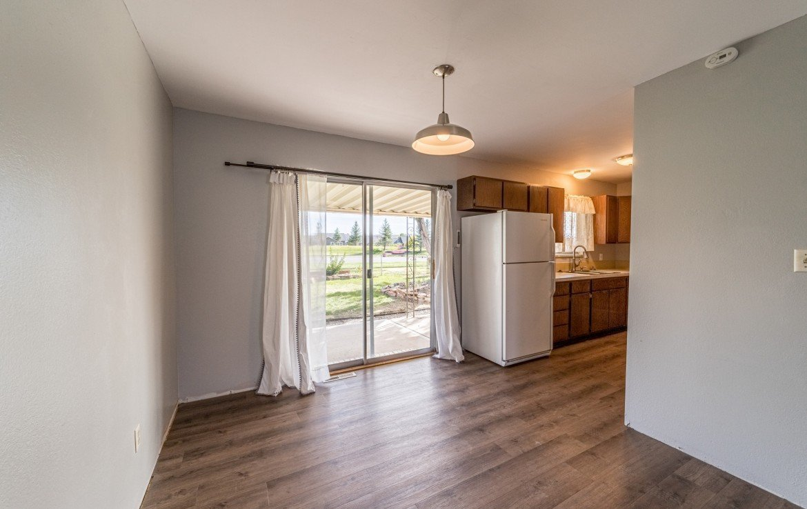 Kitchen Dining with Patio Access - 1717 Dover Rd Montrose, CO 81401 - Atha Team Real Estate for Sale