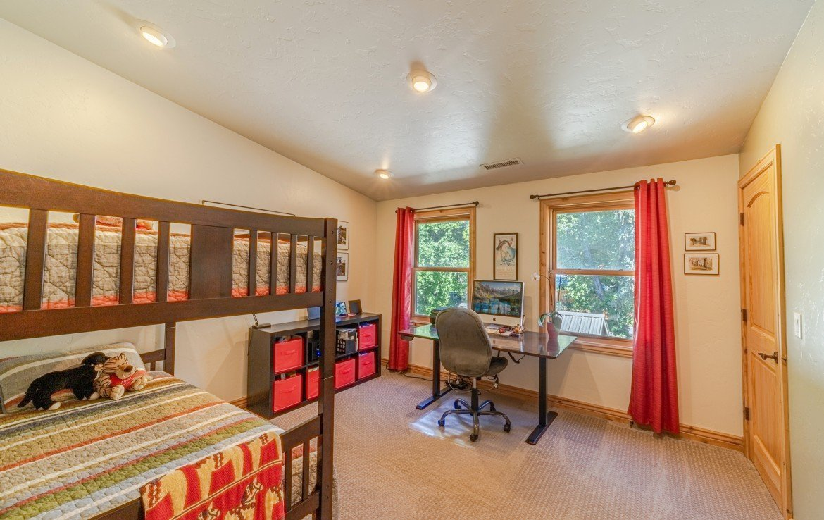 Bedroom with New Carpet and 2 Windows- 181 S. Lena St #D Ridgway, CO 81432 - Atha Team Colorado Real Estate
