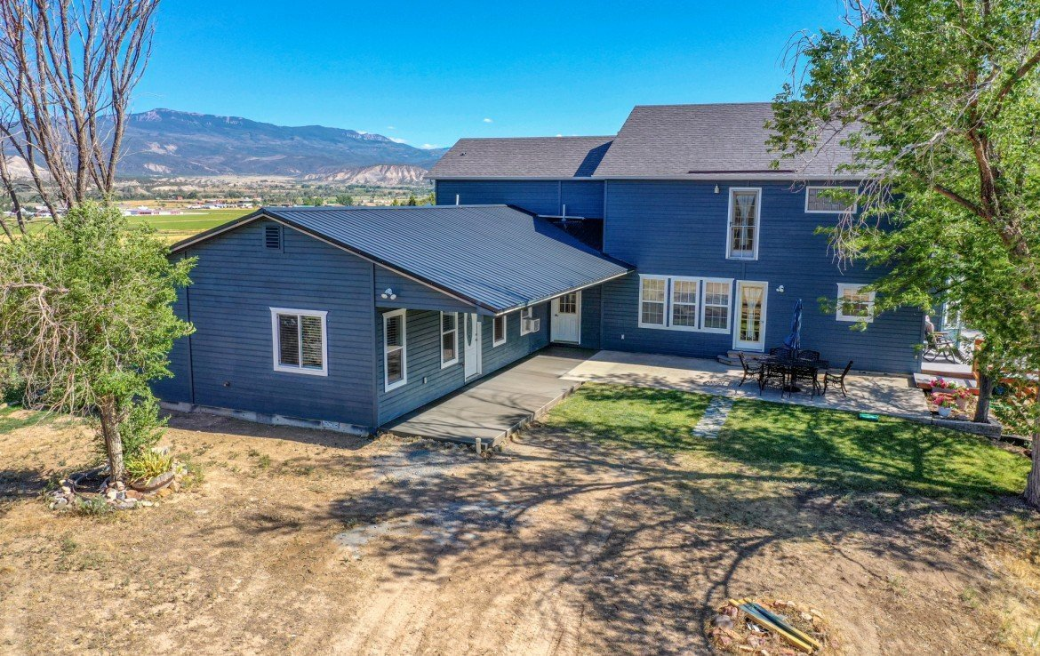 Aerial View Back of Farmhouse - 21835 Government Springs Rd - Atha Team Realty Montrose Colorado