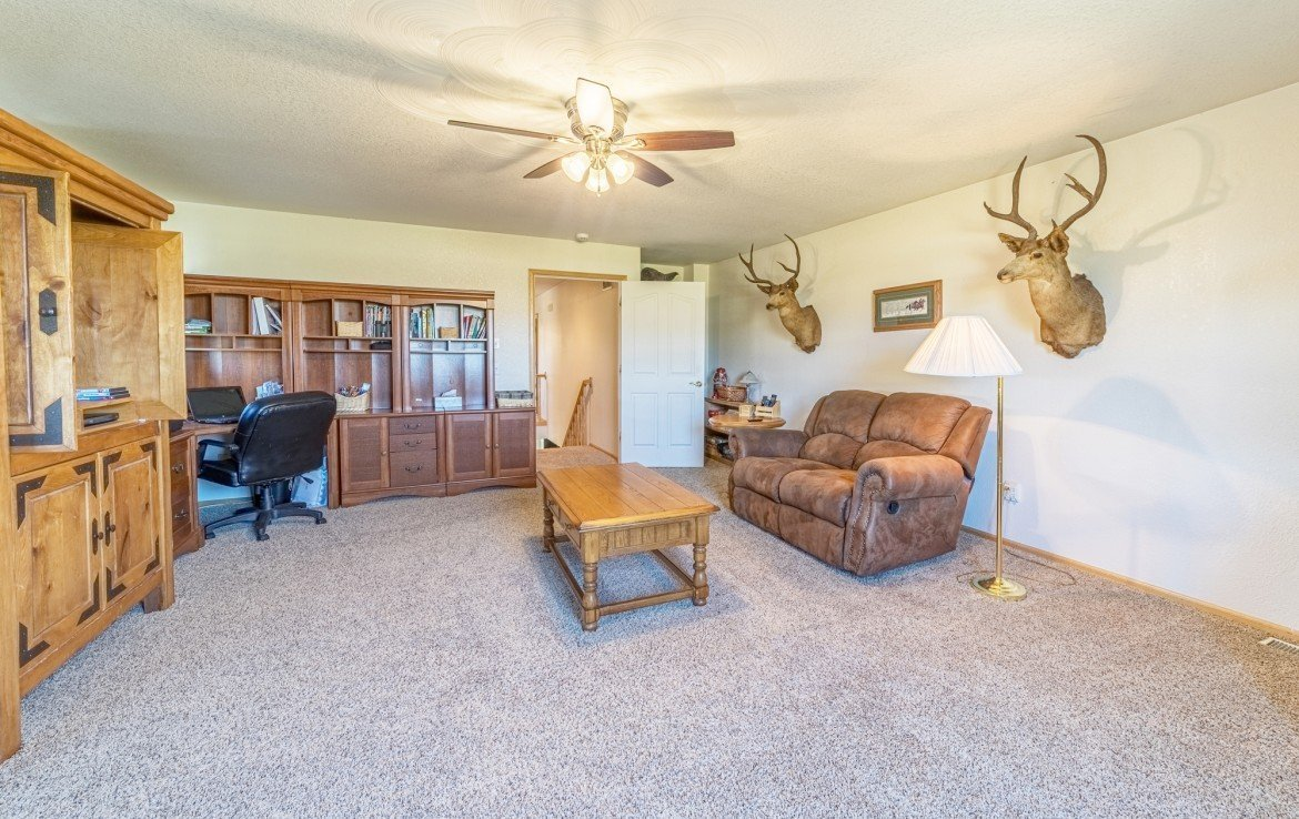 Upstairs Living Room with Ceiling Fan - 21835 Government Springs Rd - Atha Team Realty Montrose Colorado