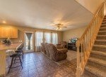 Open Concept Kitchen/Living - 21835 Government Springs Rd - Atha Team Realty Montrose Colorado