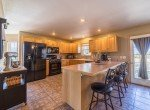 Kitchen with Bar Seating - 21835 Government Springs Rd - Atha Team Realty Montrose Colorado