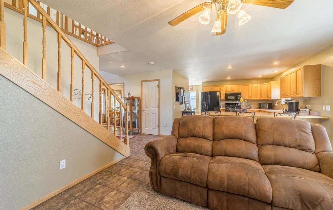 Living Room with Ceiling Fan - 21835 Government Springs Rd - Atha Team Realty Montrose Colorado