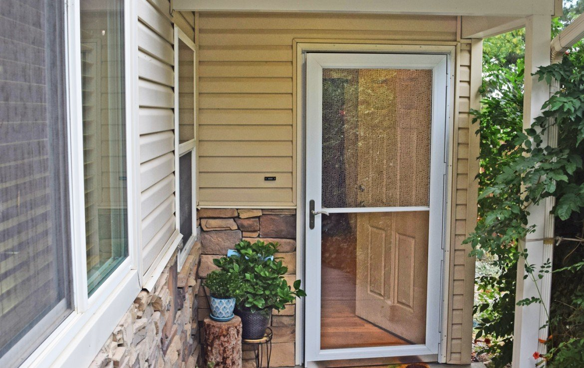 Front Entry Way with Screen Door - 1141 Anthracite Creek Ave Montrose CO 81401 - Atha Team Real Estate