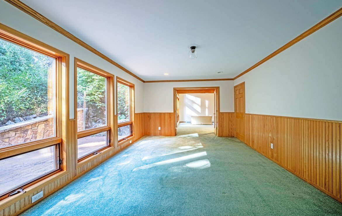 Bedroom with Wood Paneling - 430 Pinecrest Dr Ouray, CO 81427 - Atha Team Realty