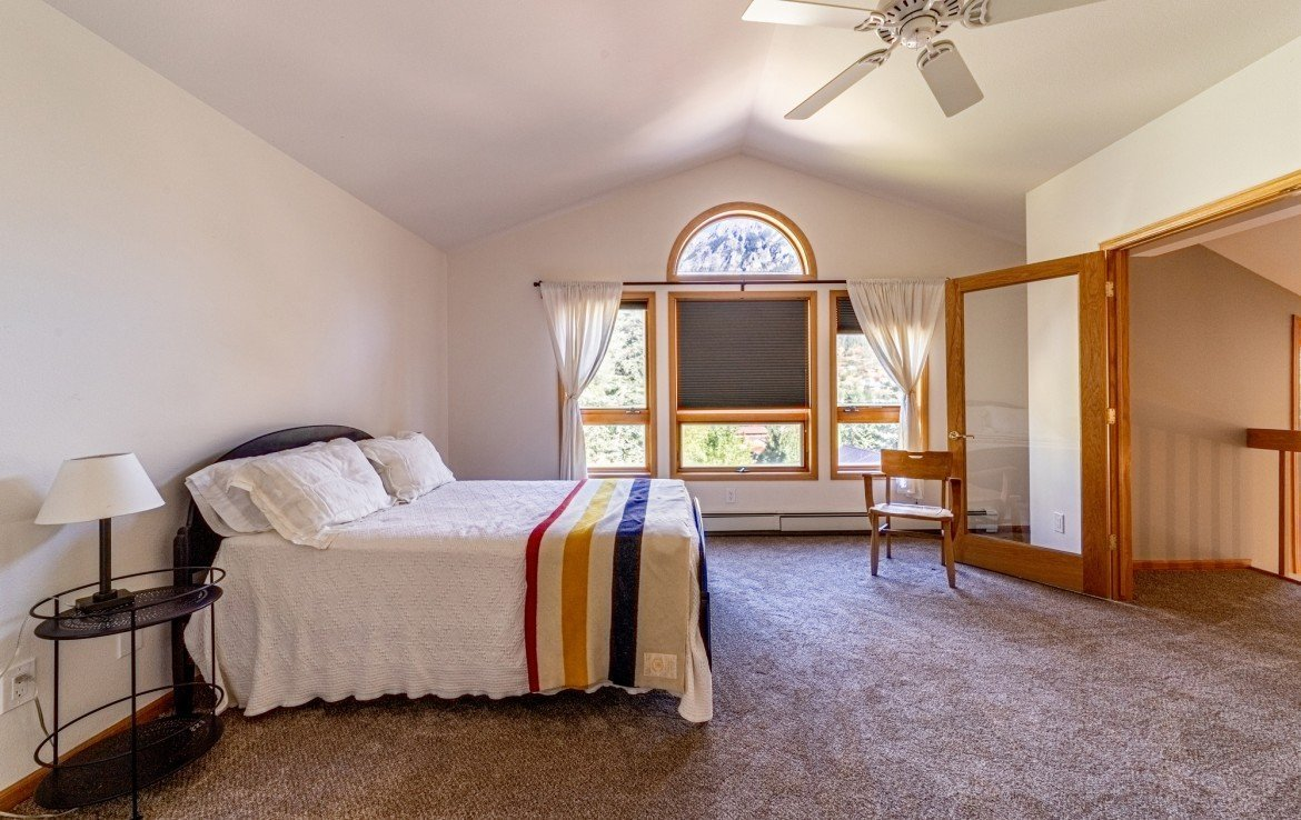 Master Bedroom with Ceiling Fan - 430 Pinecrest Dr Ouray, CO 81427 - Atha Team Realty