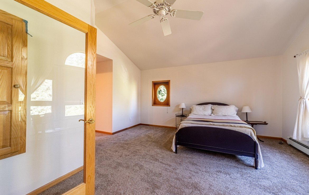 Master Bedroom with Carpeting and French Doors - 430 Pinecrest Dr Ouray, CO 81427 - Atha Team Realty