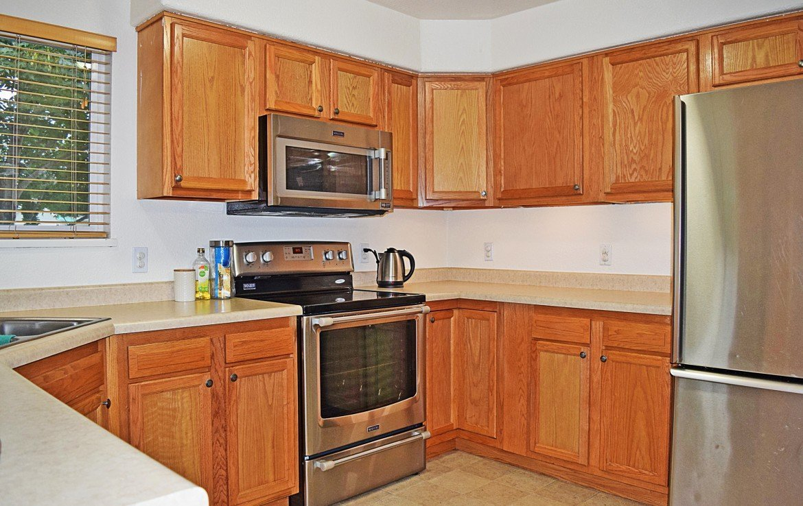 Kitchen with Stainless Steel Appliances - 1141 Anthracite Creek Ave Montrose CO 81401 - Atha Team Real Estate