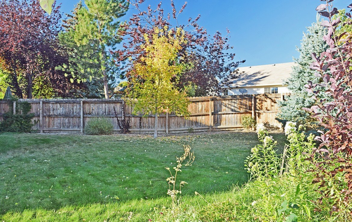 Large Back Yard with Privacy Fence - 1939 White House Dr, Montrose, CO - Atha Team Realty