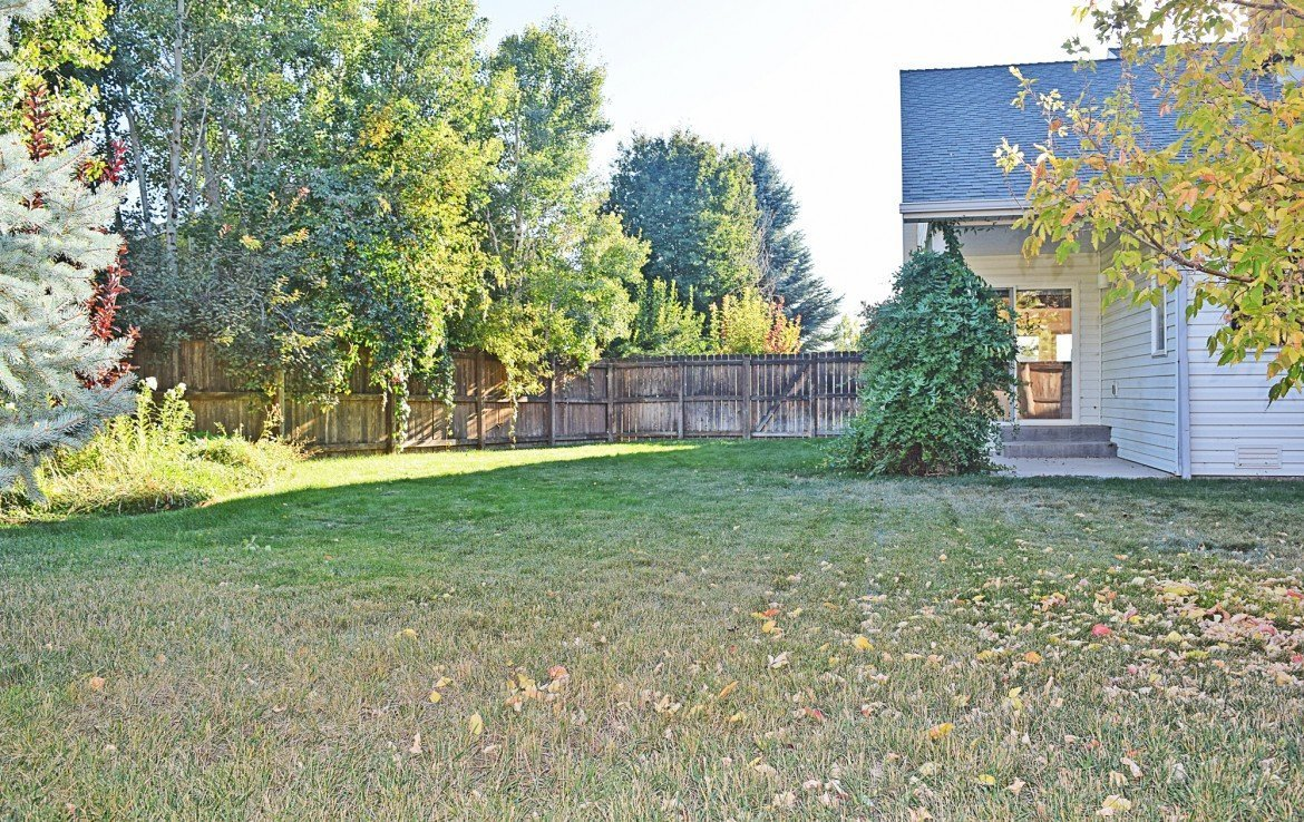 Large Back Yard with Lawn Sprinklers - 1939 White House Dr, Montrose, CO - Atha Team Realty