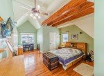 Bedroom with Open Wood Beams - 68057 Sunnyside Rd - Atha Team Realty Agents