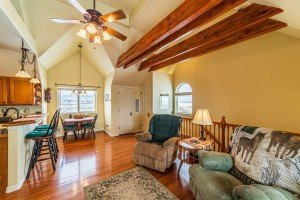 Living Room with Open Wood Beams - 68057 Sunnyside Rd - Atha Team Realty Agents