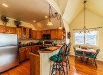 Kitchen with Bar Seating - 68057 Sunnyside Rd - Atha Team Realty Agents