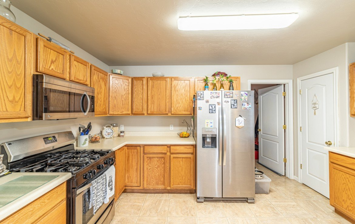 Kitchen with Stainless Steel Appliances - Atha Team Realty Agents at Keller Williams