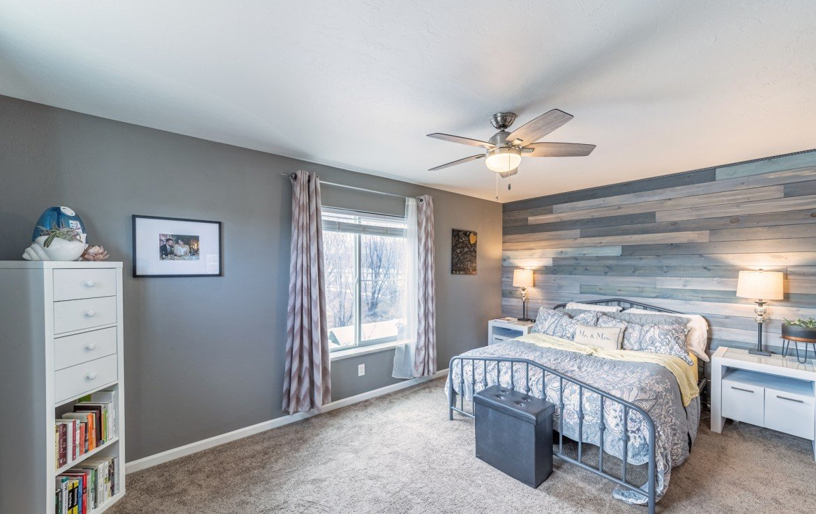 Upstairs Master Bedroom with Ceiling Fan - Atha Team Realty Agents at Keller Williams