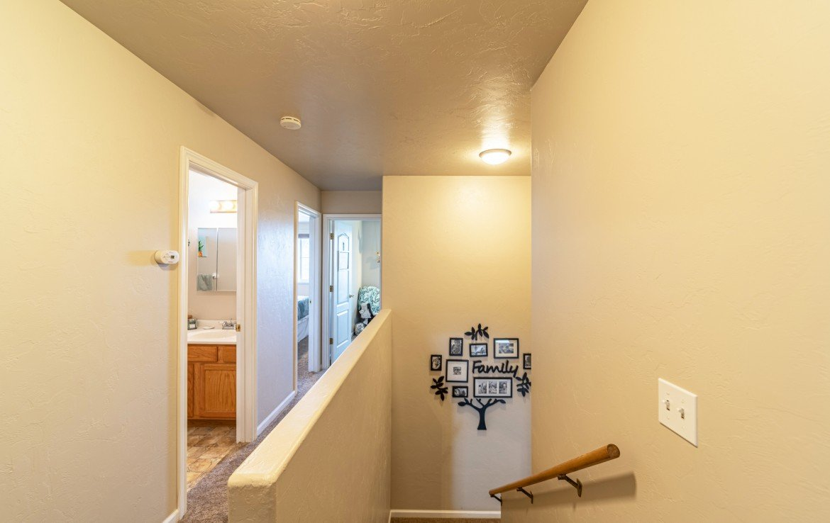 Upstairs Hallway and Stairs- Atha Team Realty Agents at Keller Williams