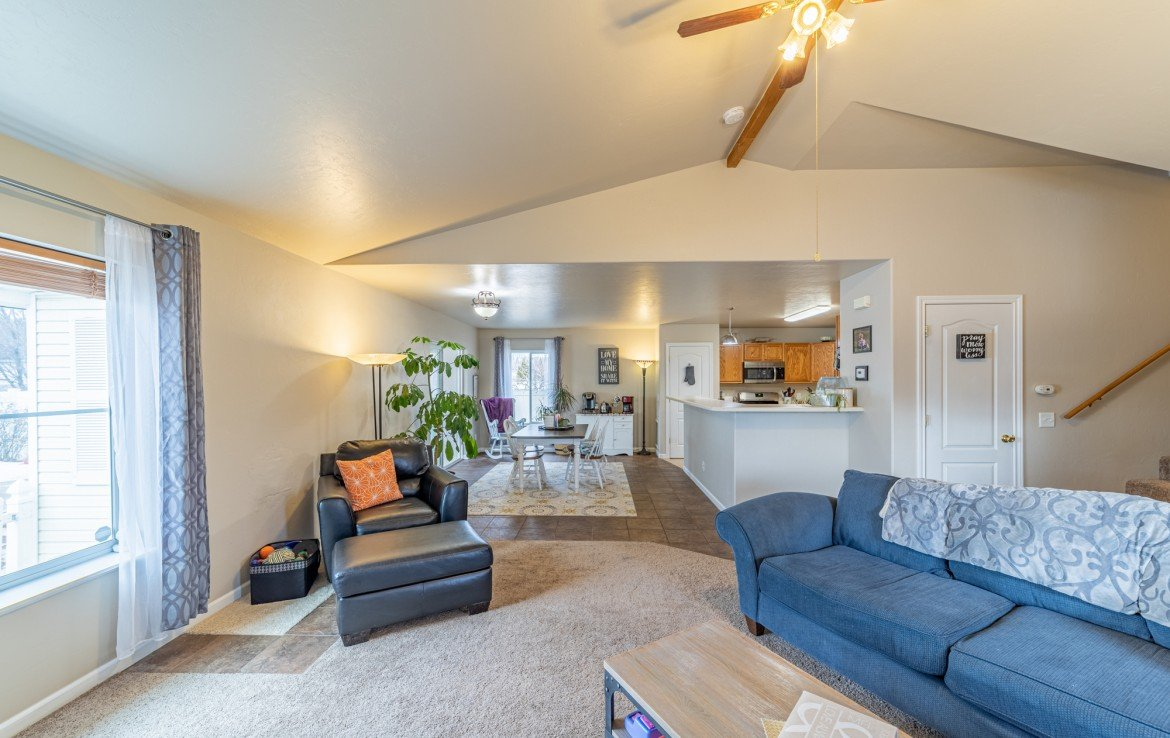 Living Room with Ceiling Fan - Atha Team Realty Agents at Keller Williams