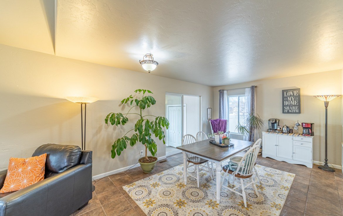 Dining Room with Sun Room Access - Atha Team Realty Agents at Keller Williams