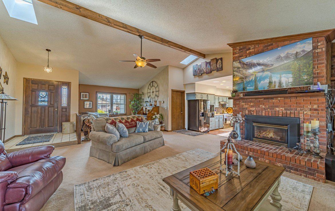 Living Room with Brick Accent Wall - 1649 Hermosa St Montrose, CO 81401 - Atha Team Real Estate