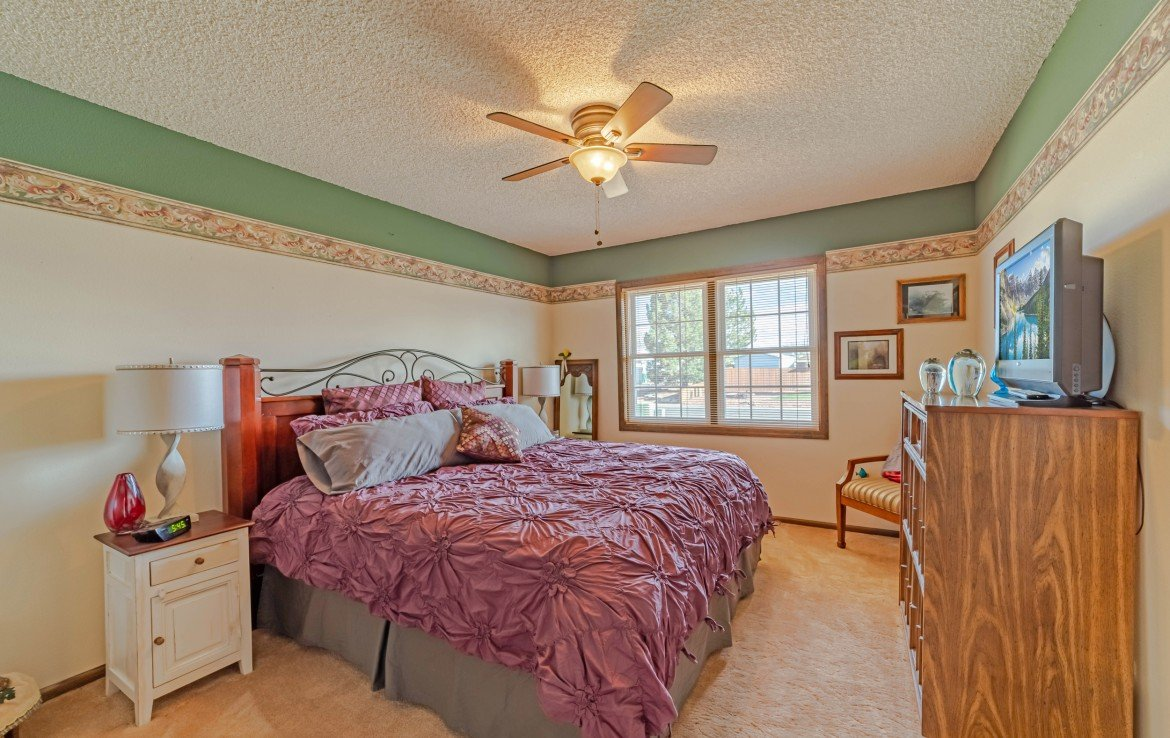 Second Bedroom with Ceiling Fan - 1649 Hermosa St Montrose, CO 81401 - Atha Team Real Estate
