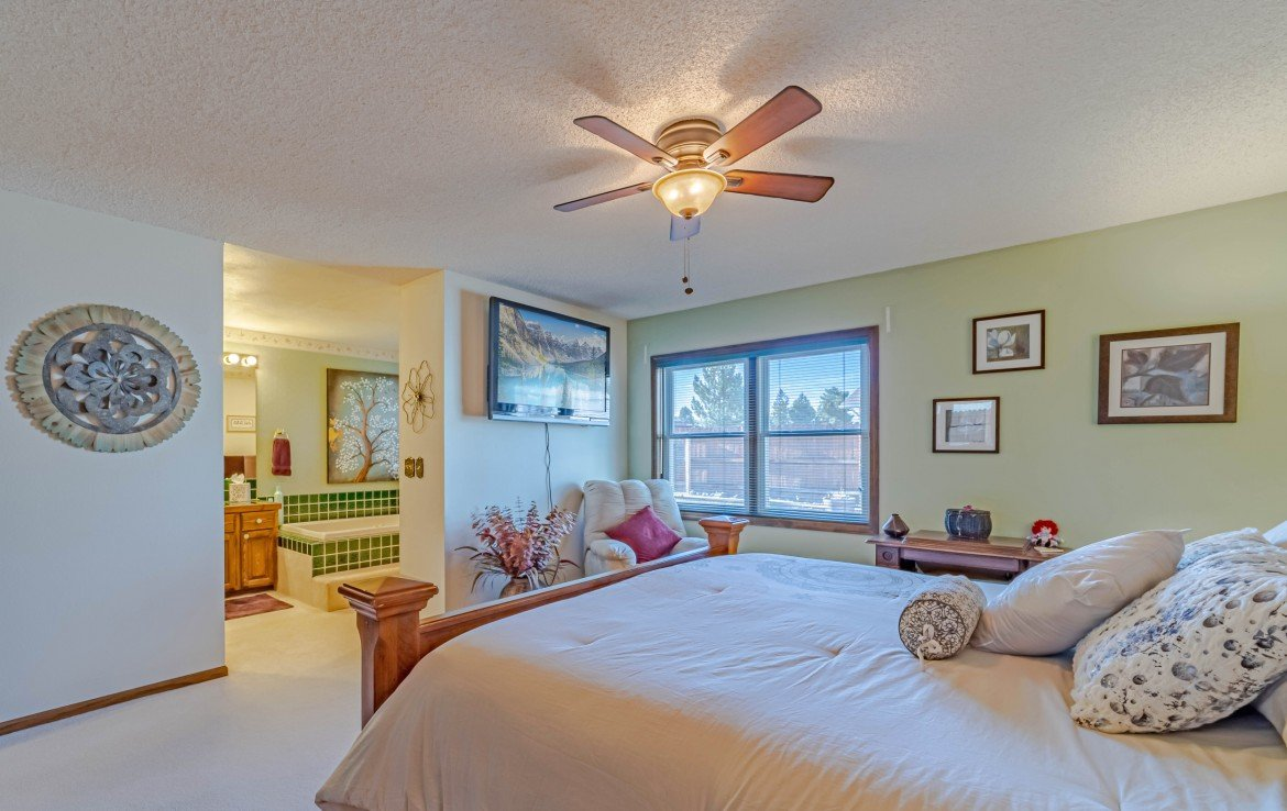 Master Bedroom with Ceiling Fan - 1649 Hermosa St Montrose, CO 81401 - Atha Team Real Estate