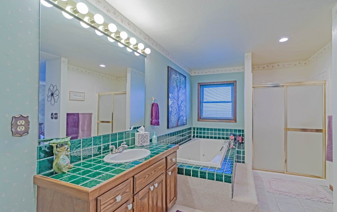 Guest Bathroom with Tile Bathtub - 1649 Hermosa St Montrose, CO 81401 - Atha Team Real Estate