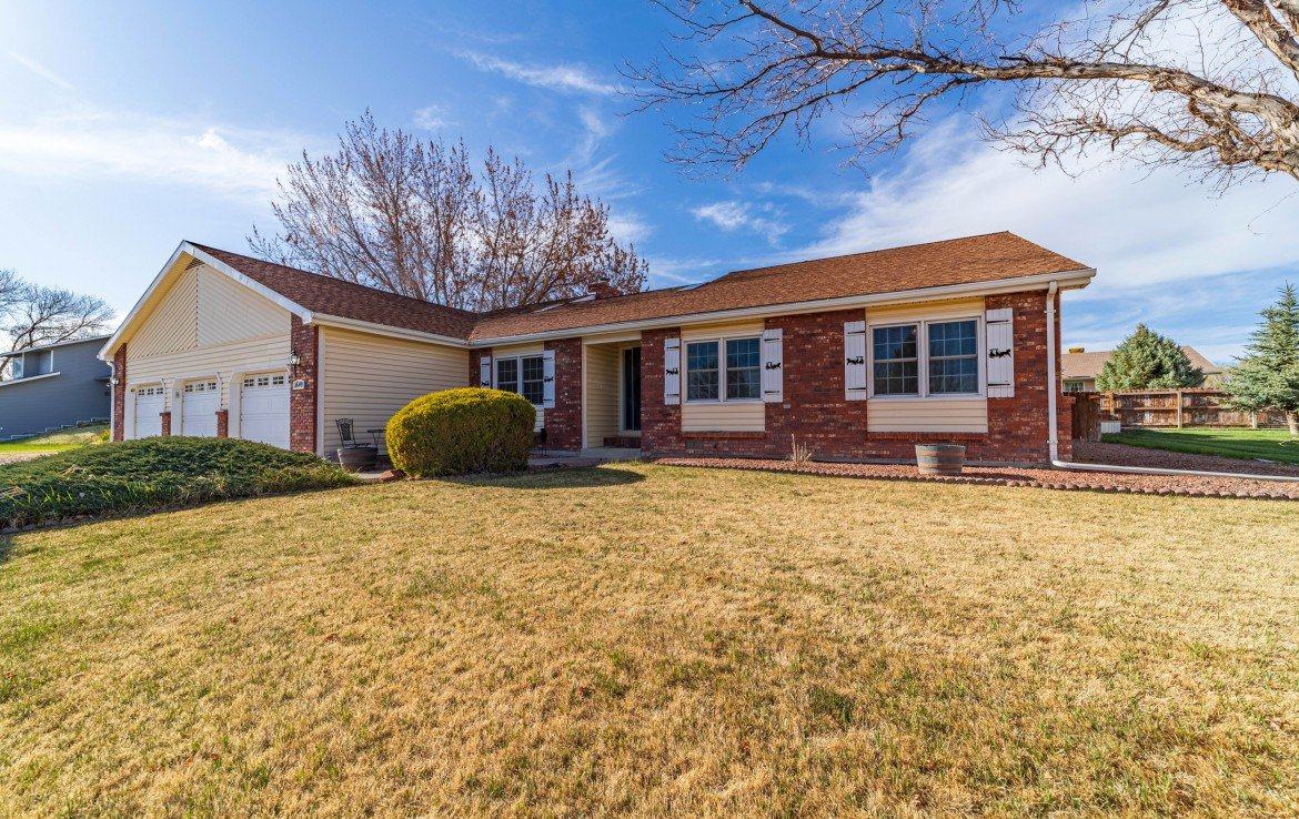 Brick Siding with Window Shutters - 1649 Hermosa St Montrose, CO 81401 - Atha Team Real Estate