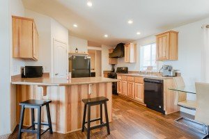Kitchen with Counter Seating - 121 Castle Ave Montrose CO - Atha Team Property