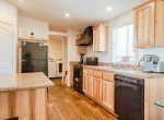 Kitchen with Laminate Floors - 121 Castle Ave Montrose CO - Atha Team Property