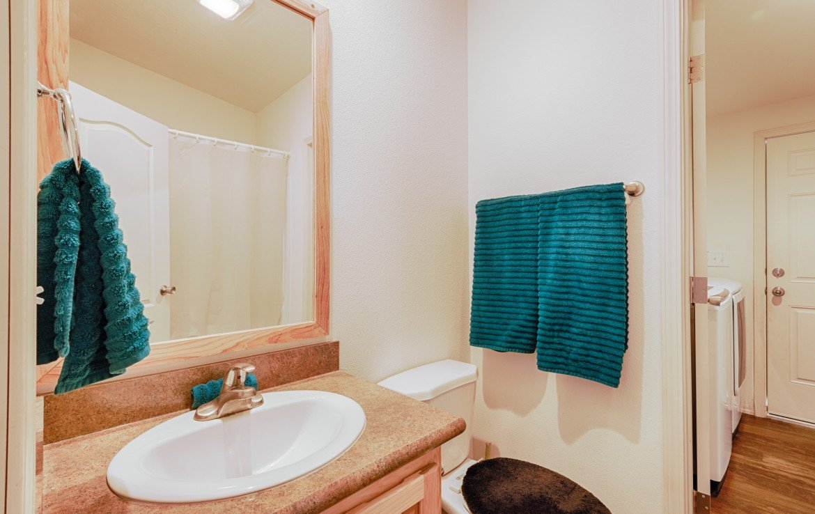 Guest Bath with Vanity - 121 Castle Ave Montrose CO - Atha Team Property
