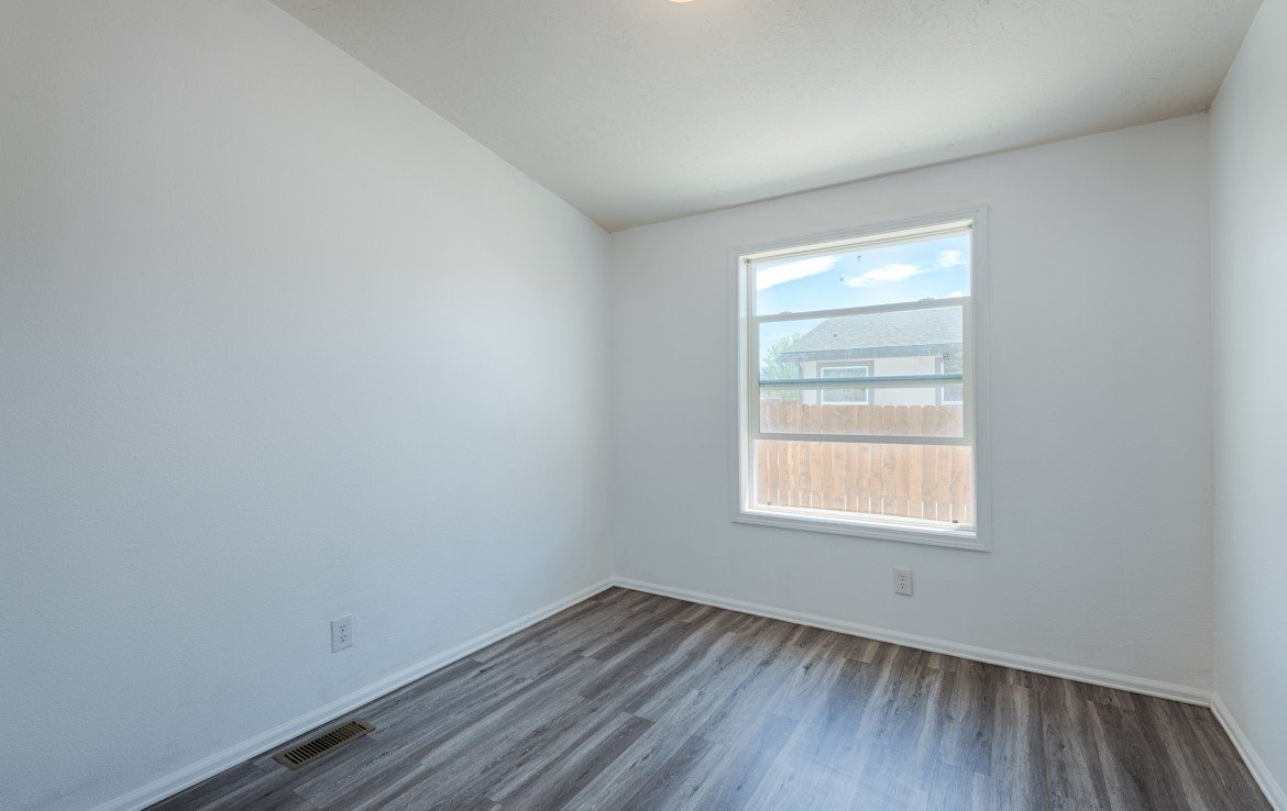 Bedroom with Laminate Flooring - 121 Castle Ave Montrose CO - Atha Team Property