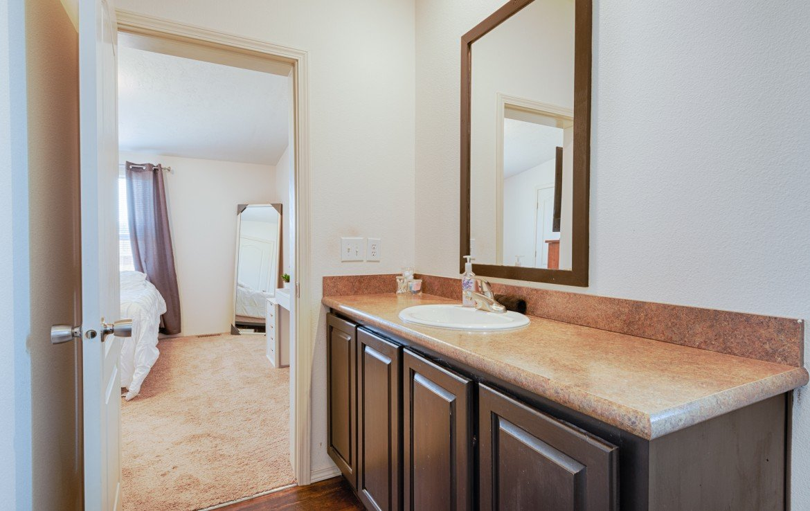 Master Bathroom with Laminate Floors - 121 Castle Ave Montrose CO - Atha Team Property