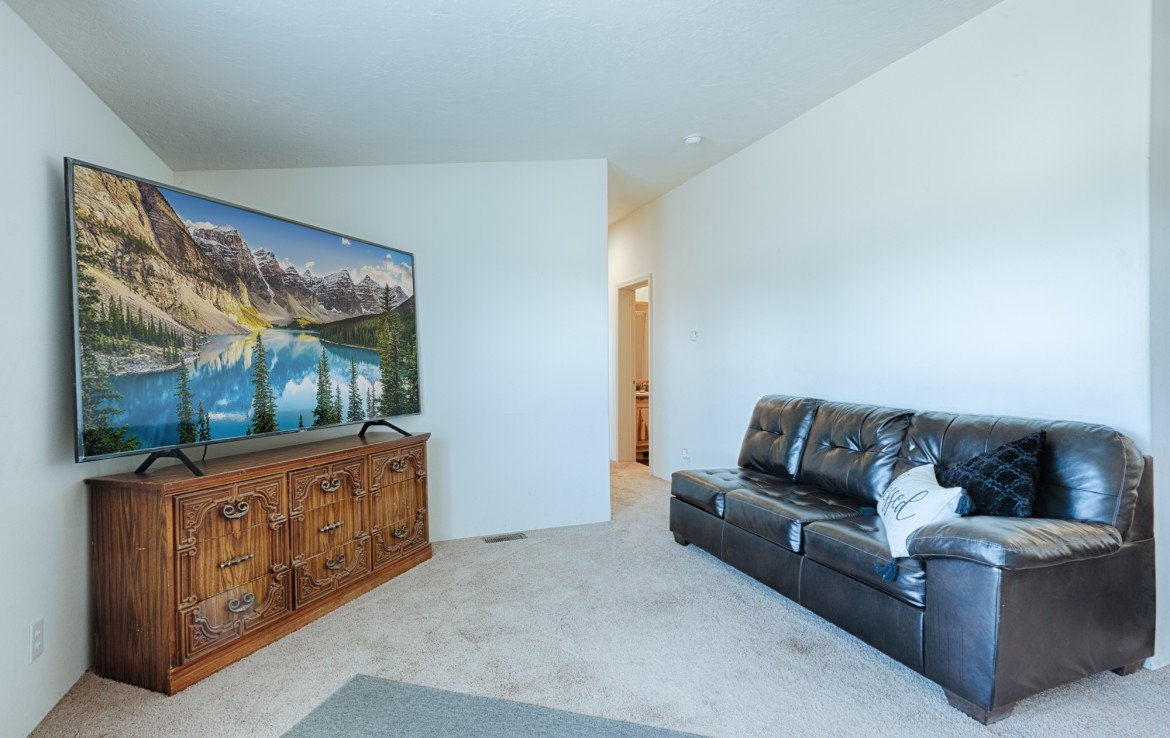 Living Room with Carpeting - 121 Castle Ave Montrose CO - Atha Team Property