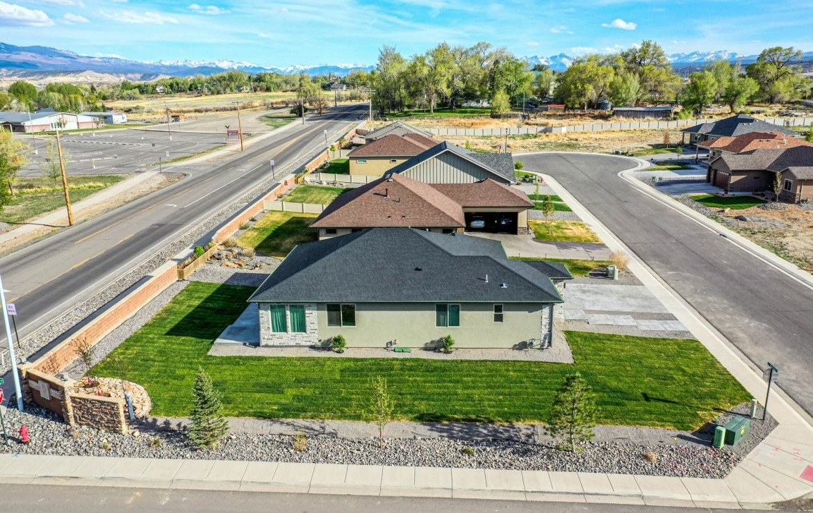 Aerial View North Side of Home with Mountain Views - 3501 Woodbridge Pl Montrose CO 81401 - Atha Team Real Estate