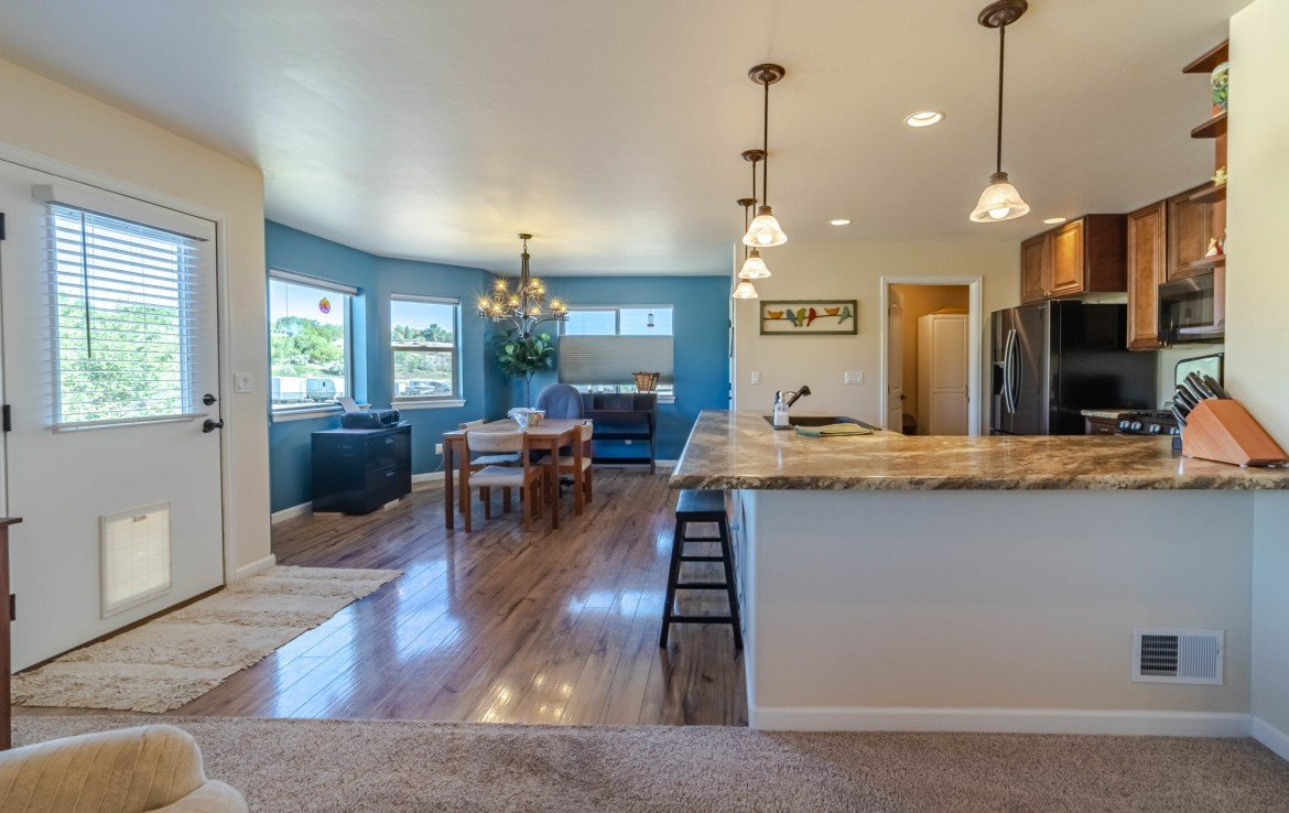 Kitchen and Dining - 413 Alta Lakes Ave Montrose, CO - Atha Team Realty